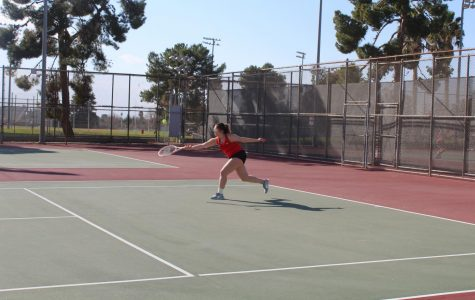 Chasidy Sotello uses her quick reflexes to catch the ball in time.