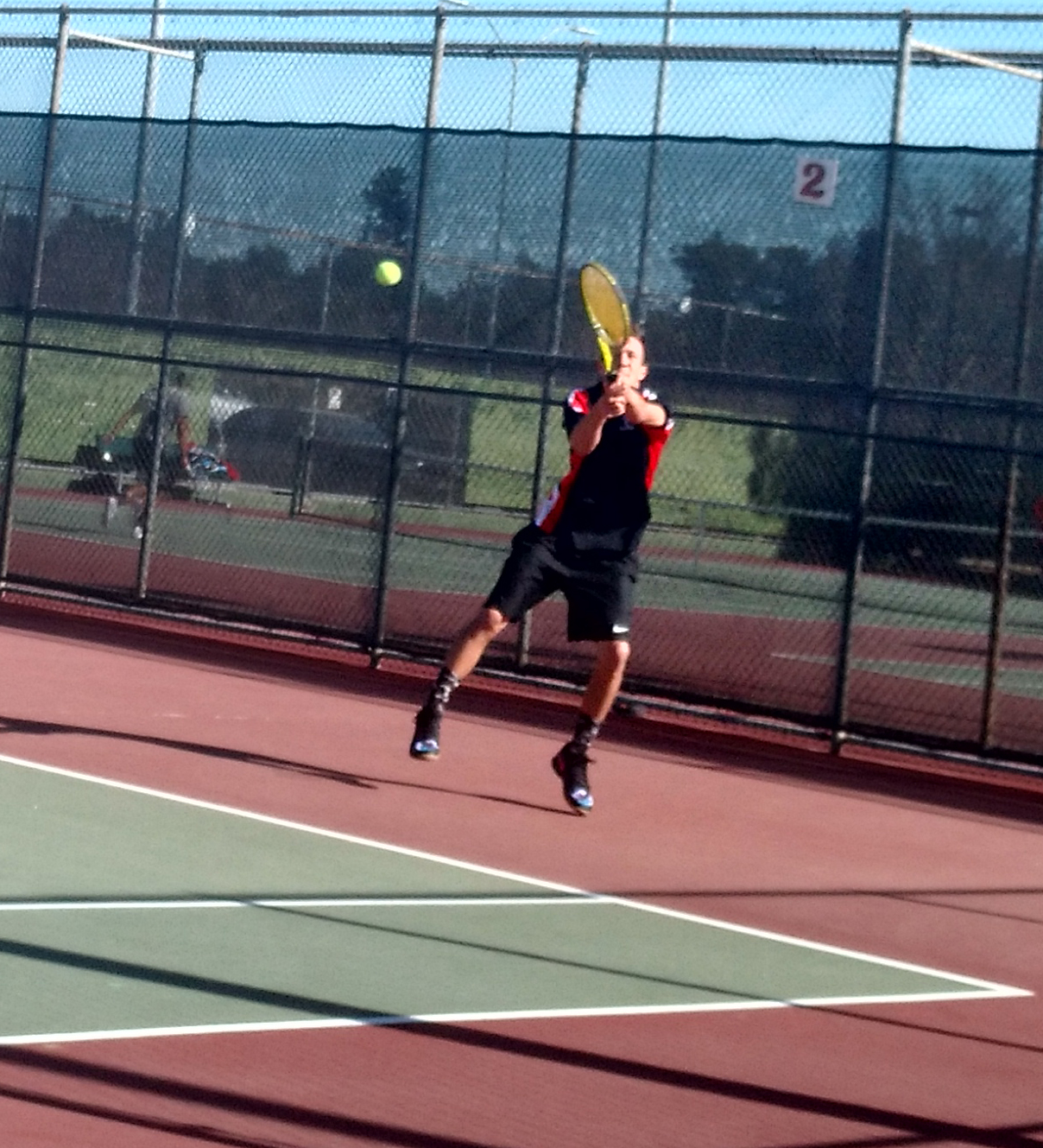 Caleb Johnson lands intense hit mid-air in his single match.