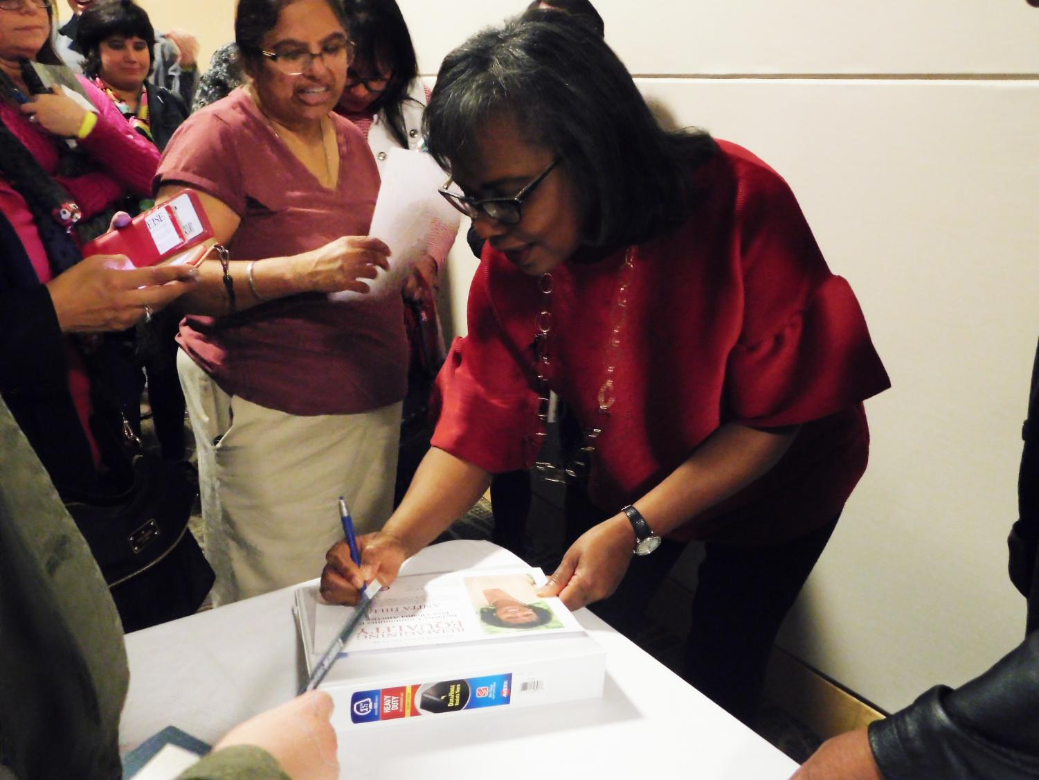 Anita Hill signs books