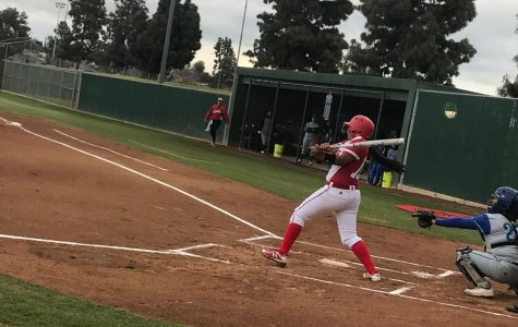 Naizemarie Ubay giving it her all in a strong swing.