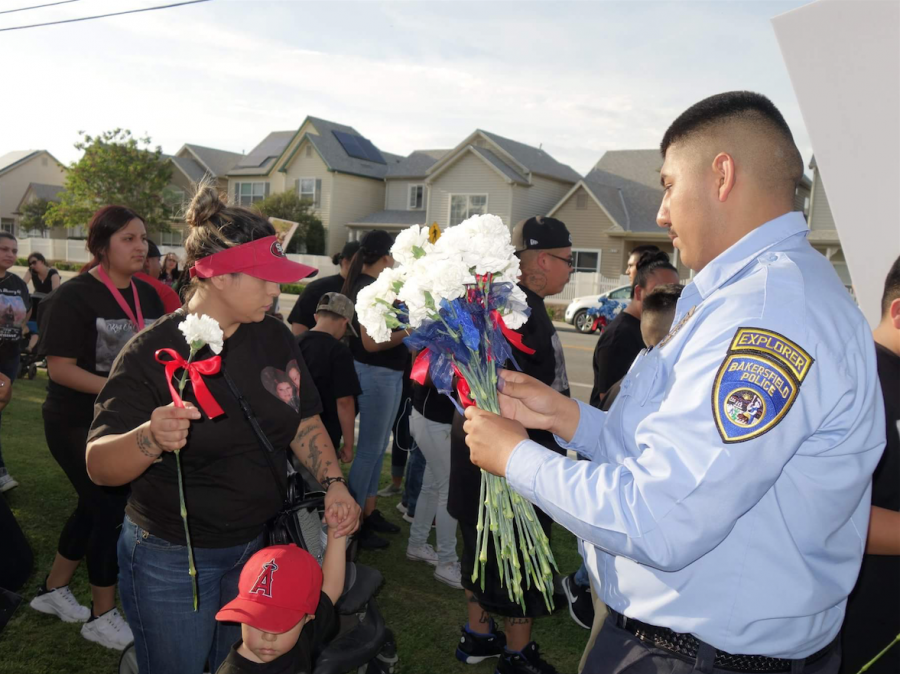 BPD+officer+gives+flowers+to+marchers