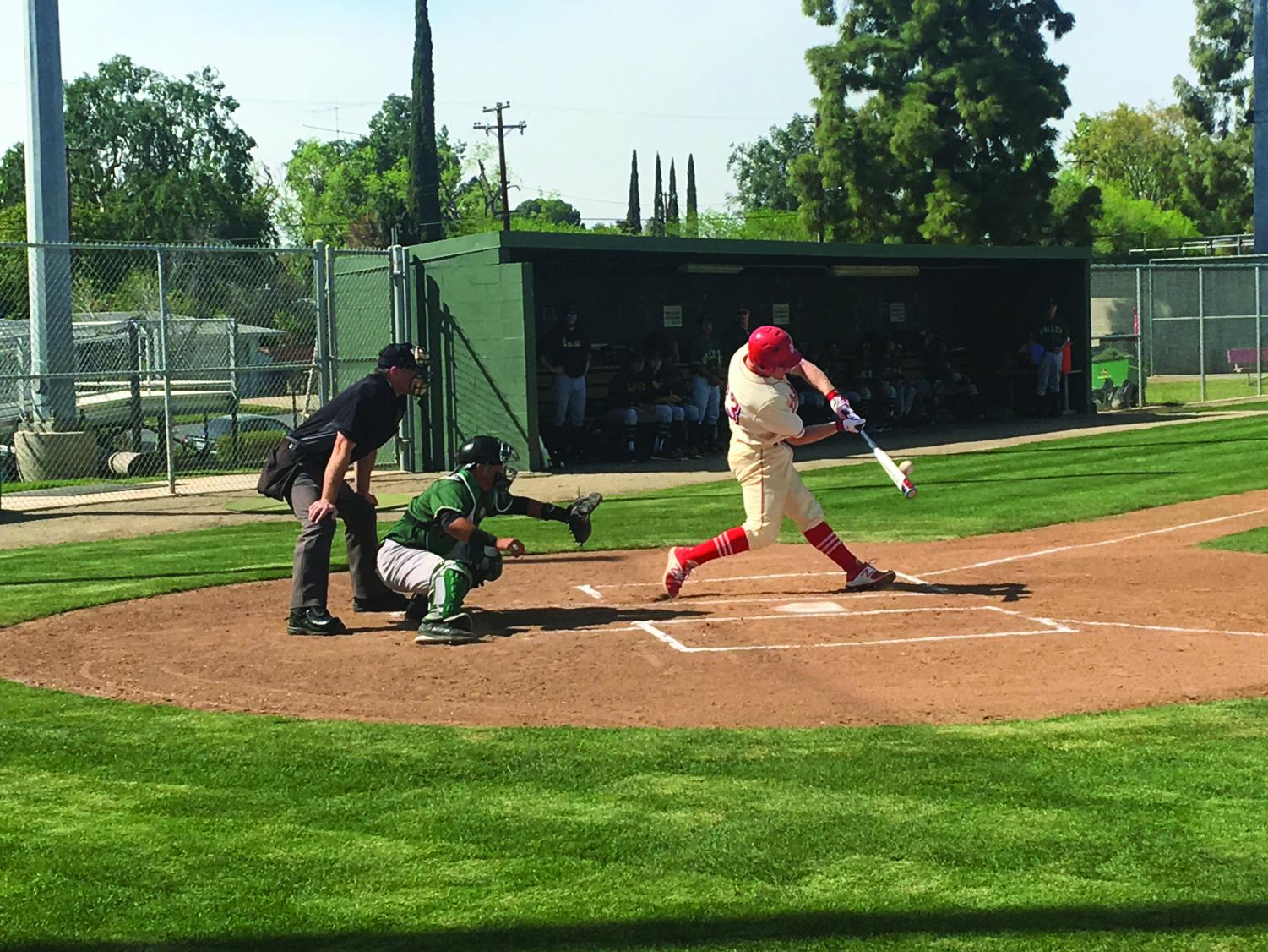 Bakersfield College player Zach Williams driving through the ball in the bottom of the fourth inning against LA Valley at Gerry Collis Field.