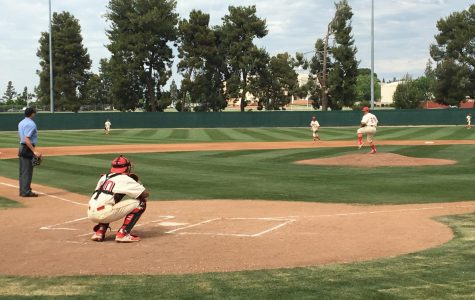 Bakersfield College pitcher Chris Diaz on the mound warming up with catcher Kyle Willman in their game against LA Valley College on April 10.