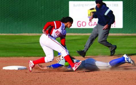 During the home game at Bakersfield College against Allan Hancock College, BC's Jordan Jimenez attempts to tag an incoming runner sliding onto second base.