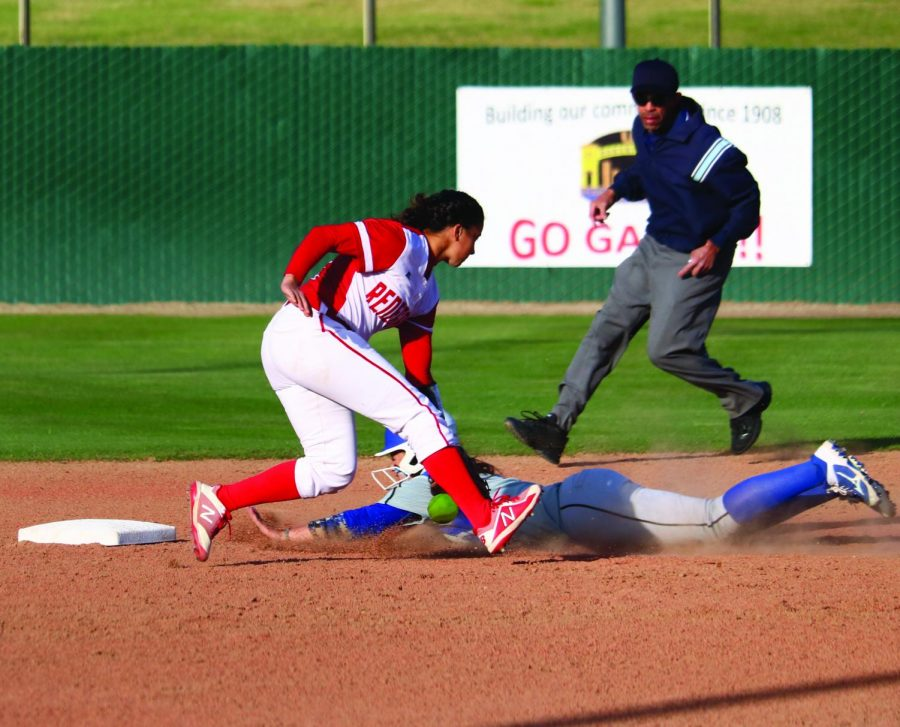 During+the+home+game+at+Bakersfield+College+against+Allan+Hancock+College%2C+BC%E2%80%99s+Jordan+Jimenez+attempts+to+tag+an+incoming+runner+sliding+onto+second+base.+