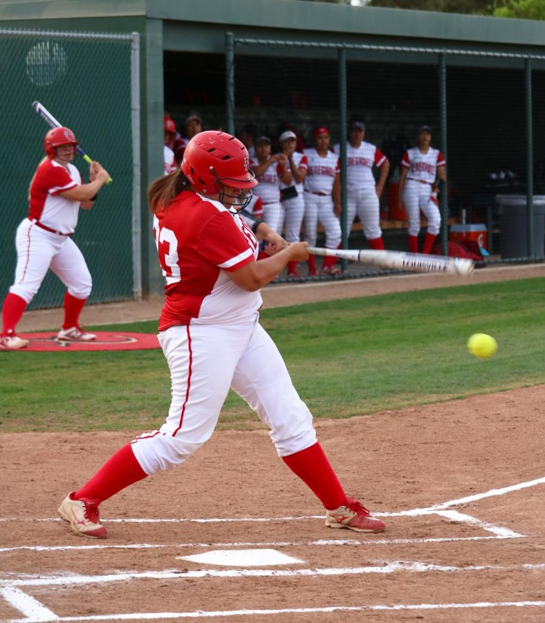 McKenna+Valencia+of+Bakersfield+College+hitting+the+softball+and+running+to+first+base+at+the+home+game+against+Santa+Monica+College.+