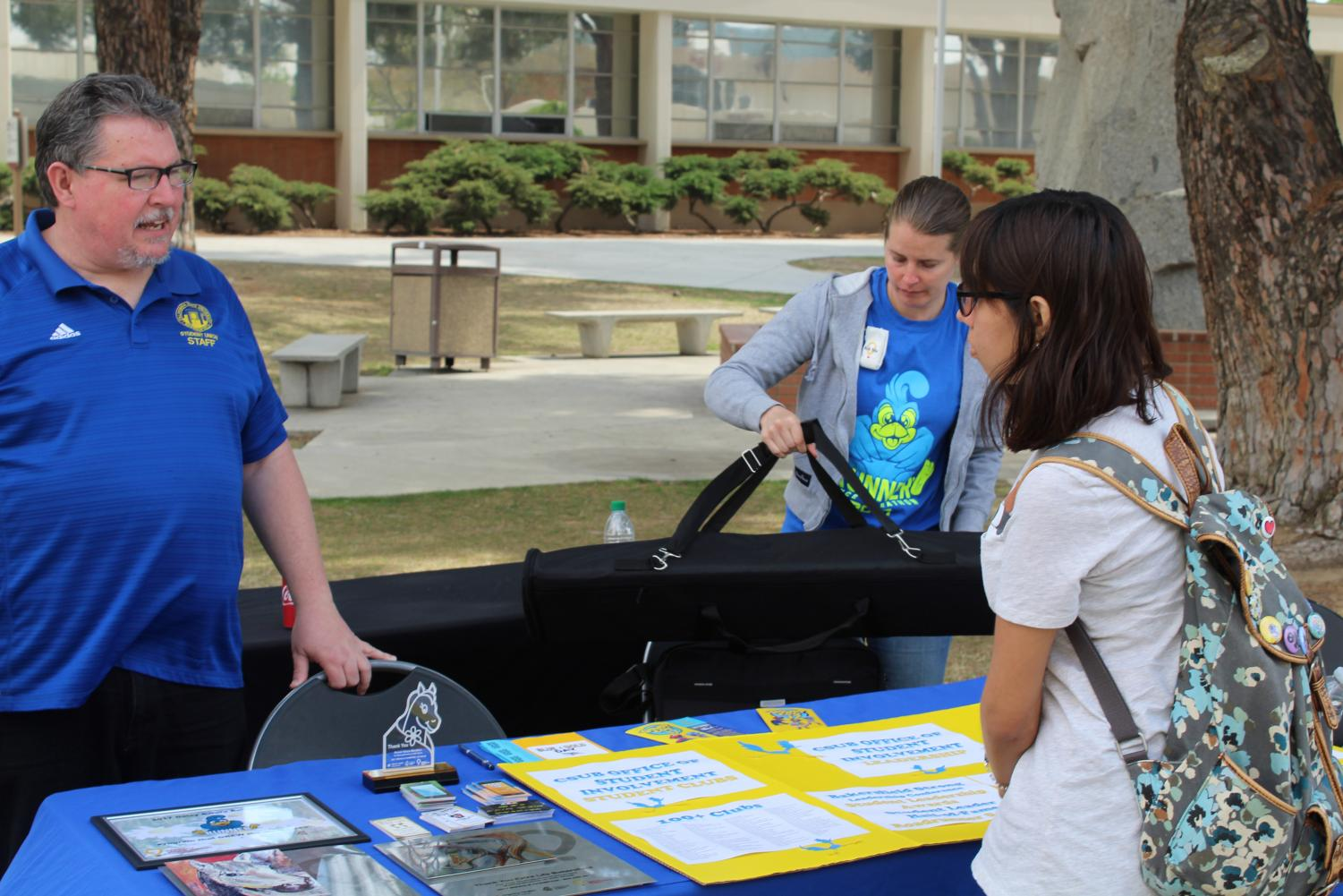 Ed Webb talks to a student about clubs at CSUB.