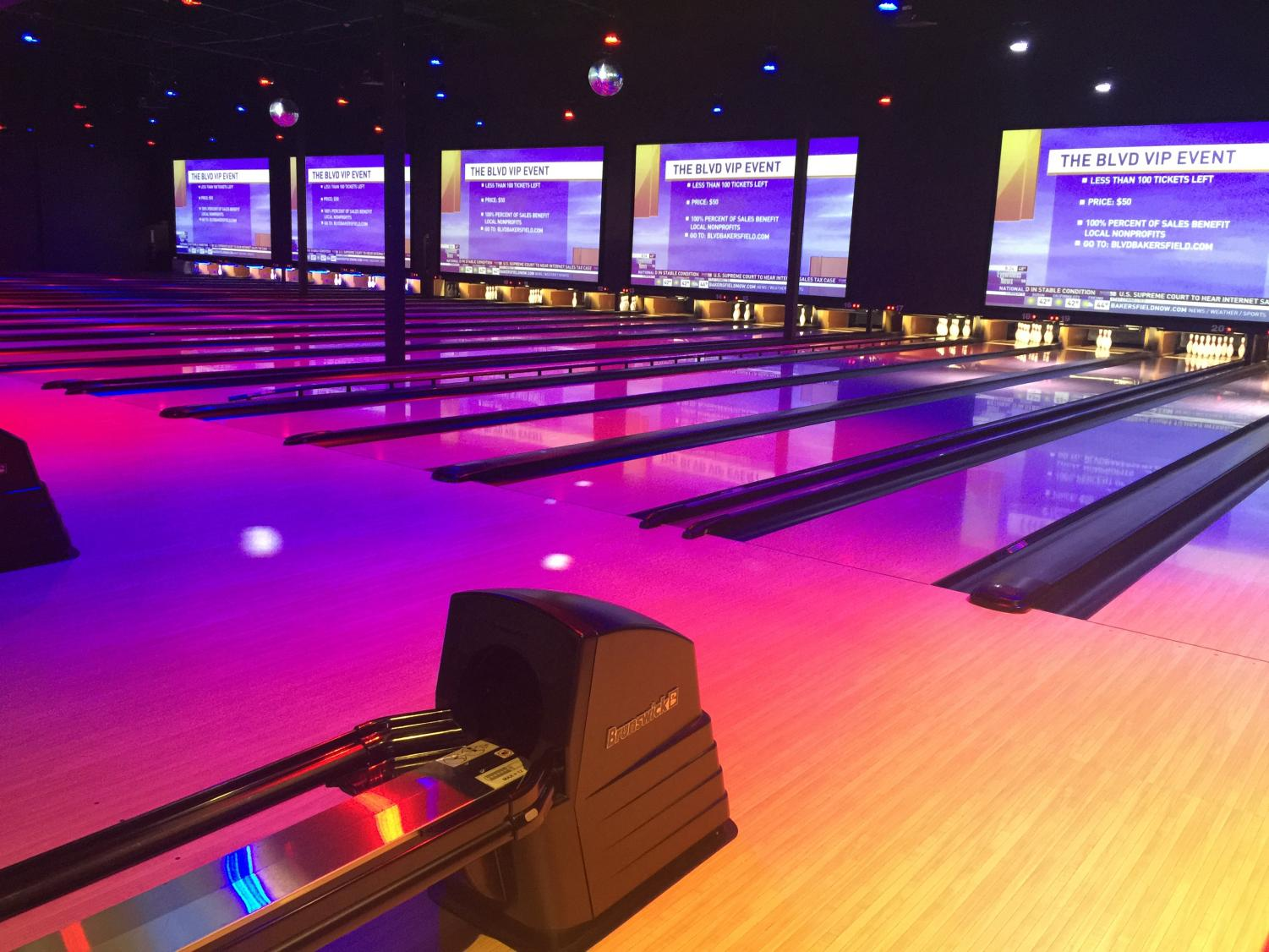 Bowling lanes are lit up at the BLVD, hotspot entertainment center on Buck Ownens Blvd.