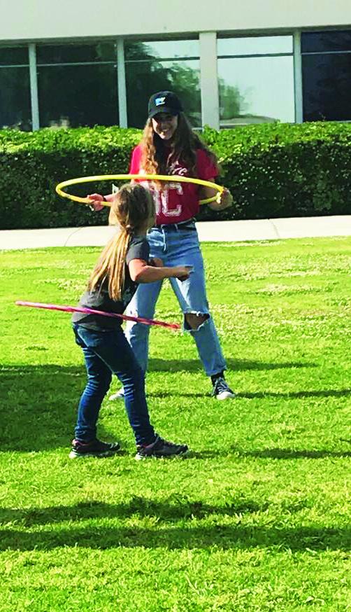 BC+Student+Life+employee+Ashly+Harp%2C+enjoys+some+hula-hoops+with+little+girl.++