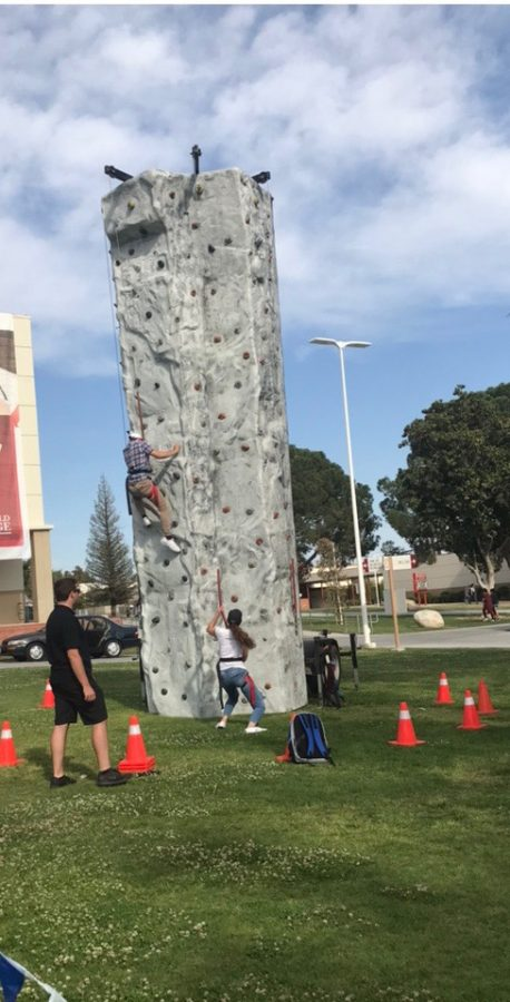 BC students put their climbing skills to the test as they go head to head on the rock climbing wall.