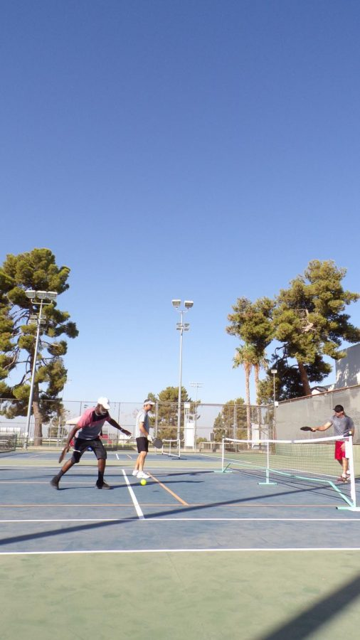 A team of four practices on the half-sized court made for pickleball.