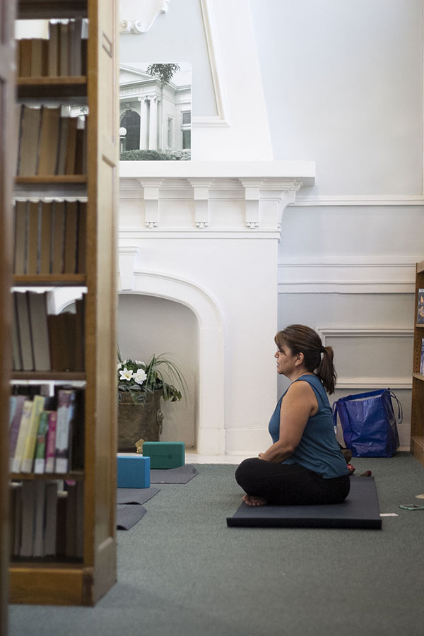 Instructor Linda Guerra ensures little interruption of library function by setting up the class in a quiet corner