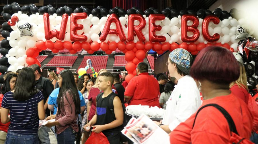 High school students walk through the BC college night booths.