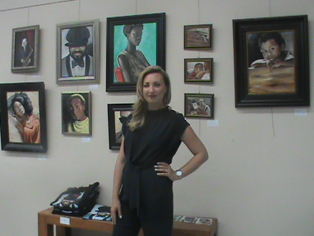 Artist+Victoria+Porter+poses+in+front+of+her+%E2%80%9CBlack+Is+Beautiful%E2%80%9D+art+collection+at+the+Bakersfield+Art+Association.