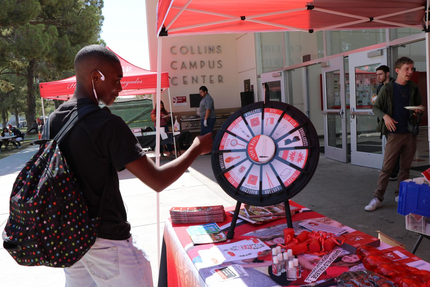 Daryl Maiden spins the wheel to get some free BC swag.