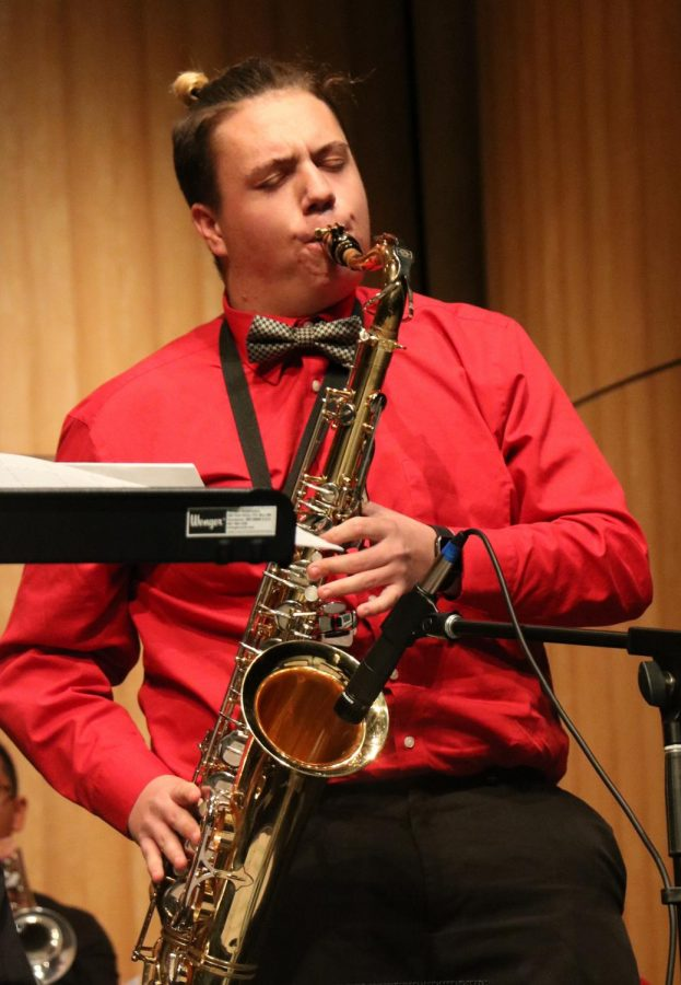 Tenor saxophone Chad Meyer plays a solo during  on the opening numbers.