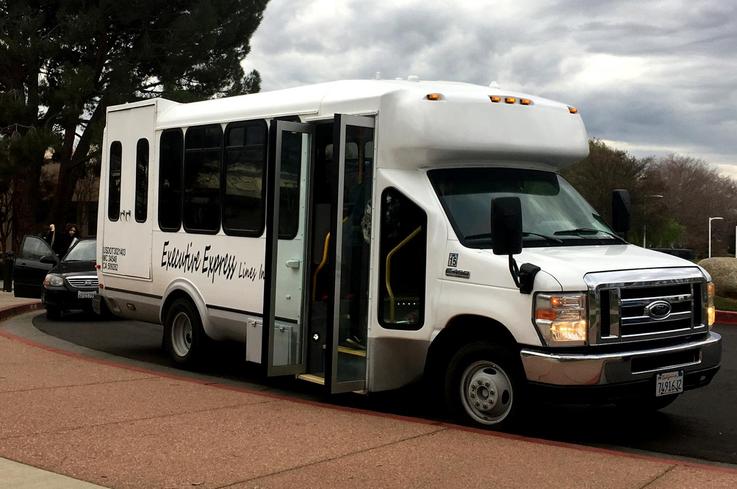 The Renegade Express shuttle waits for riders outside the administration building.