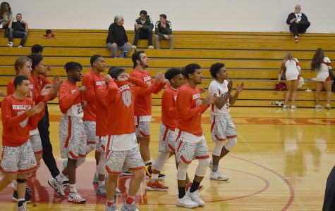 BC Men's Basketball team breaking their pregame huddle.