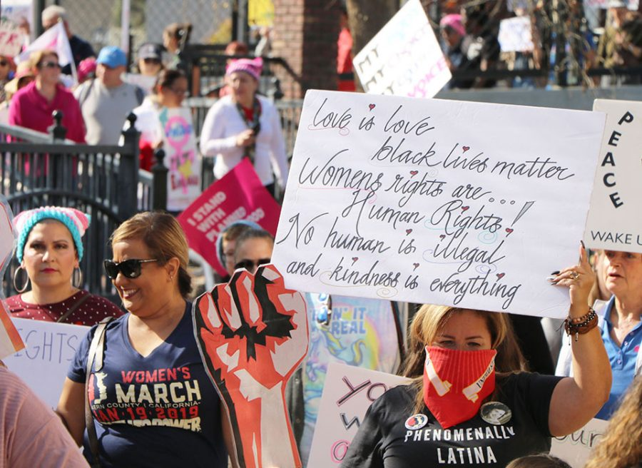 Supporters march through Mill Creek Park during Kern County Women's March.
