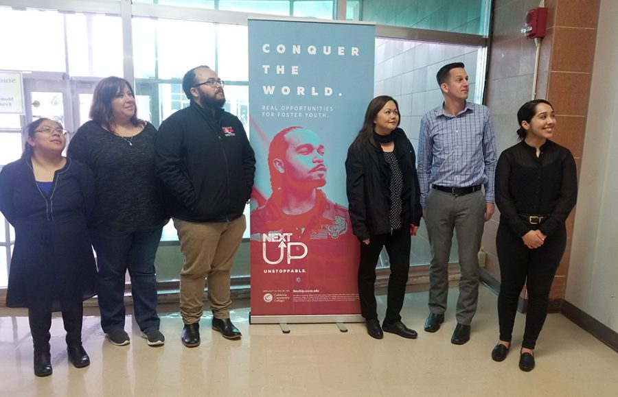 Marcela Gamino, the Educational Advisor. Maria Rojas, the Department Assistant. Chase Amos, the Educational Advisor. Imelda Simos-Valdez, a director. Jeff Stambook, a Counselor. Maria Baltazar, the Program Manager pose by the NextUp program banner.