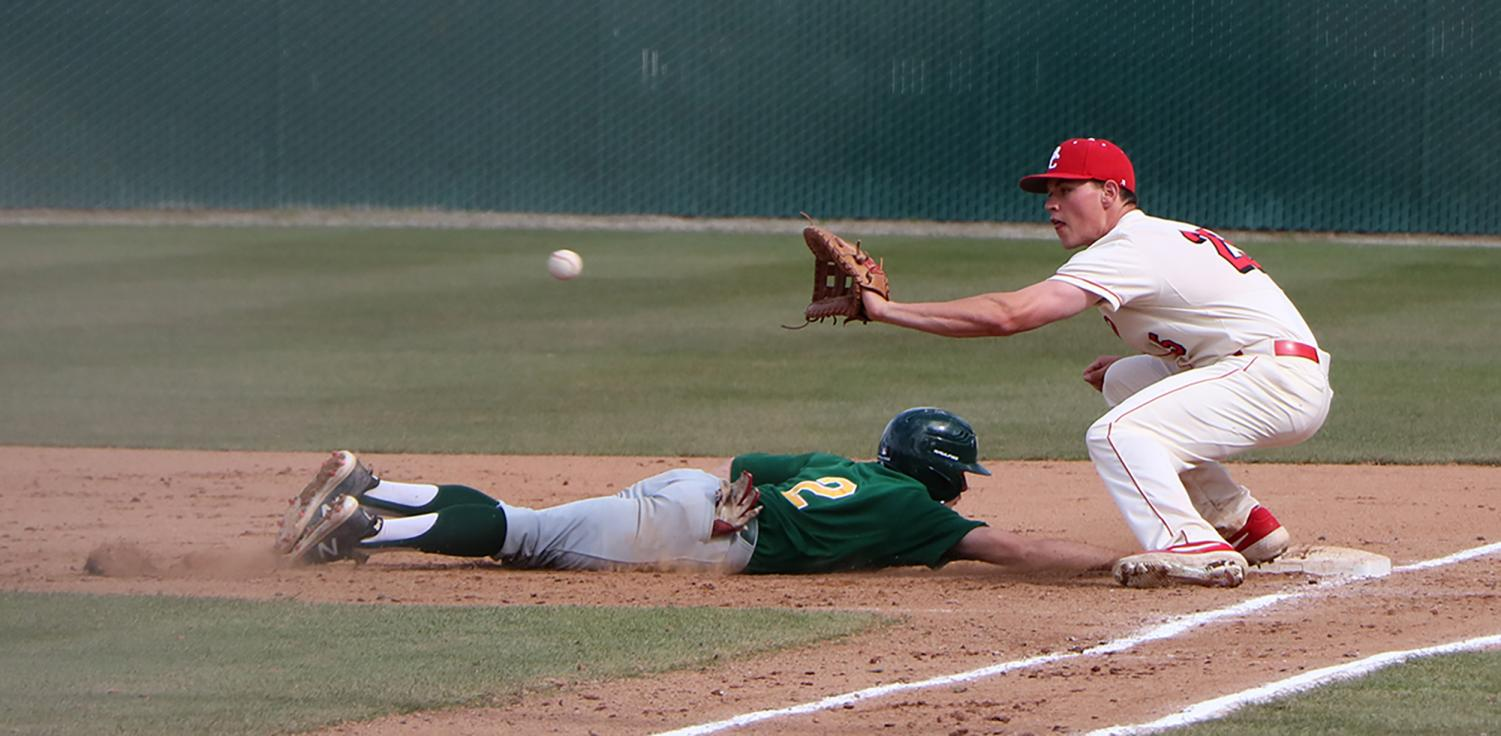 First baseman Trey Harmon trying to get the runner out on first.