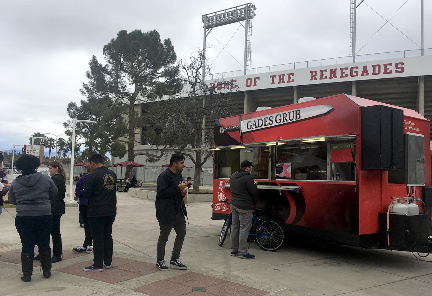 BC students wait for the next round of free samples at the Gades Grub food truck.