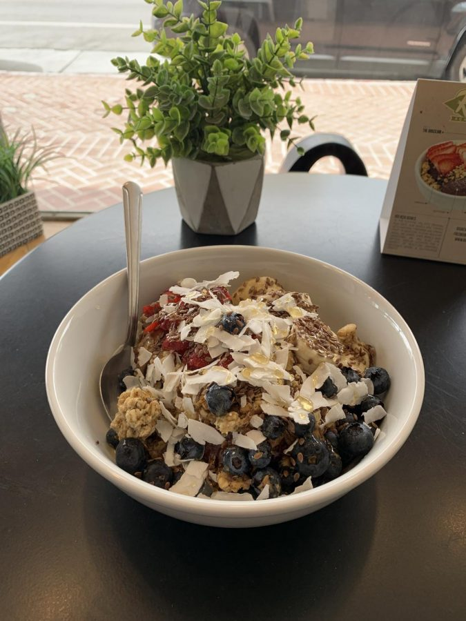 """The """"Paleo,"""" an Açai bowl topped with blueberries, coconut, granola, banana, and strawberries."""