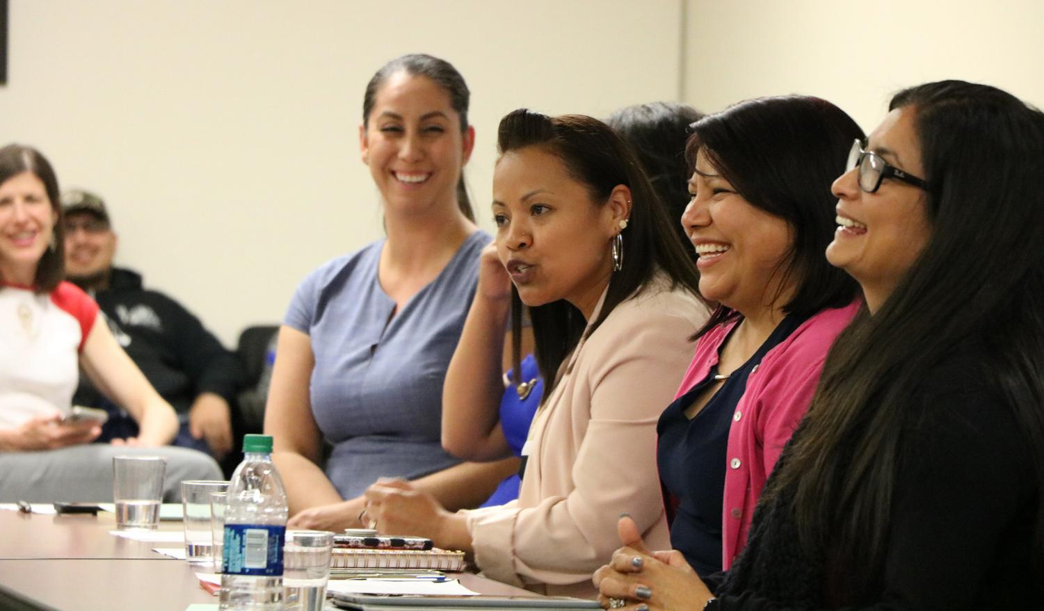 """(From far left to right) Amber Tovar, Isabel Bravo, Rosa Lopez, and Olivia Garcia discussing at the roundtable led by BC's Latinas Unidas Club titled, """"Navigating Higher Education"""" on April 10."""
