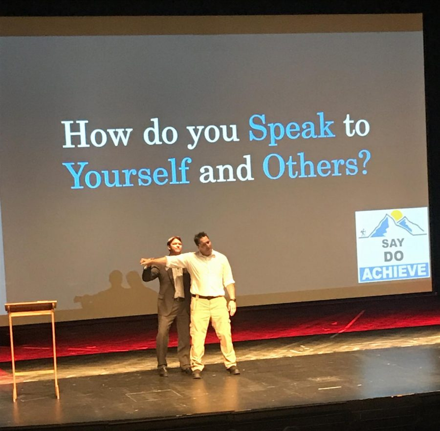Thomas Blackwell teaches the power of positivity in an experiment with an audience member at BC's indoor theatre Sept. 9.