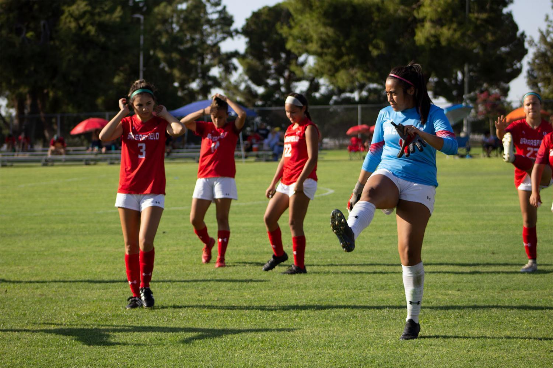 Makenna Ramirez (3), Maya Ornalez (14), Andrea Campos (22) and Aurora Fernandez (1) warming up for the game.