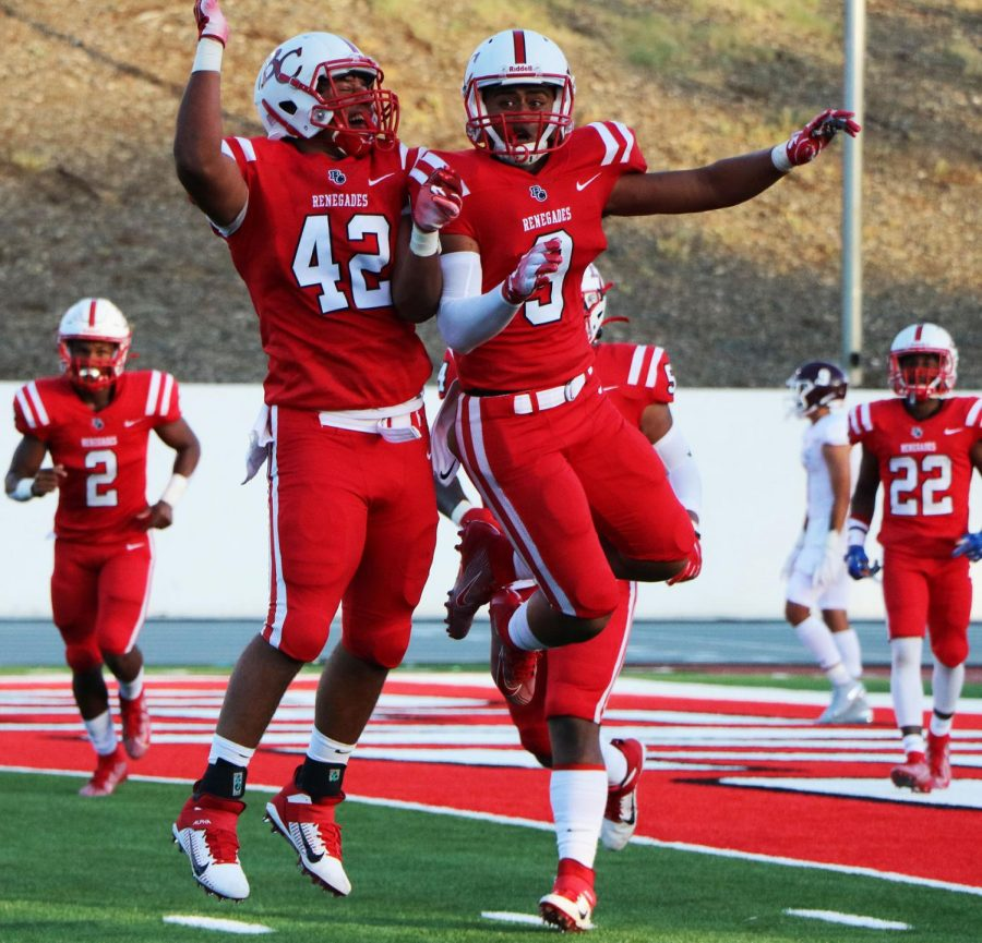 Fano Maui (9) and Cameron Williams (42) celebrates Maui's touchdown during the Renegades season opener against Mt. SAC at Bakersfield College Memorial Stadium, Sep. 7.