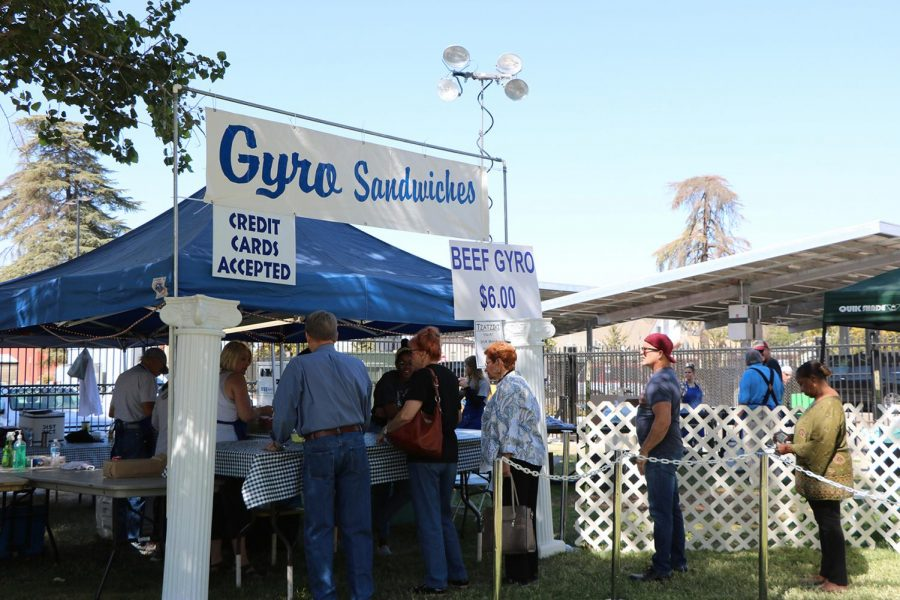 Visitors+of+the+Greek+Food+Festival+waiting+in+line+for+a+Gyro+Sandwich+on+Oct.+5.+