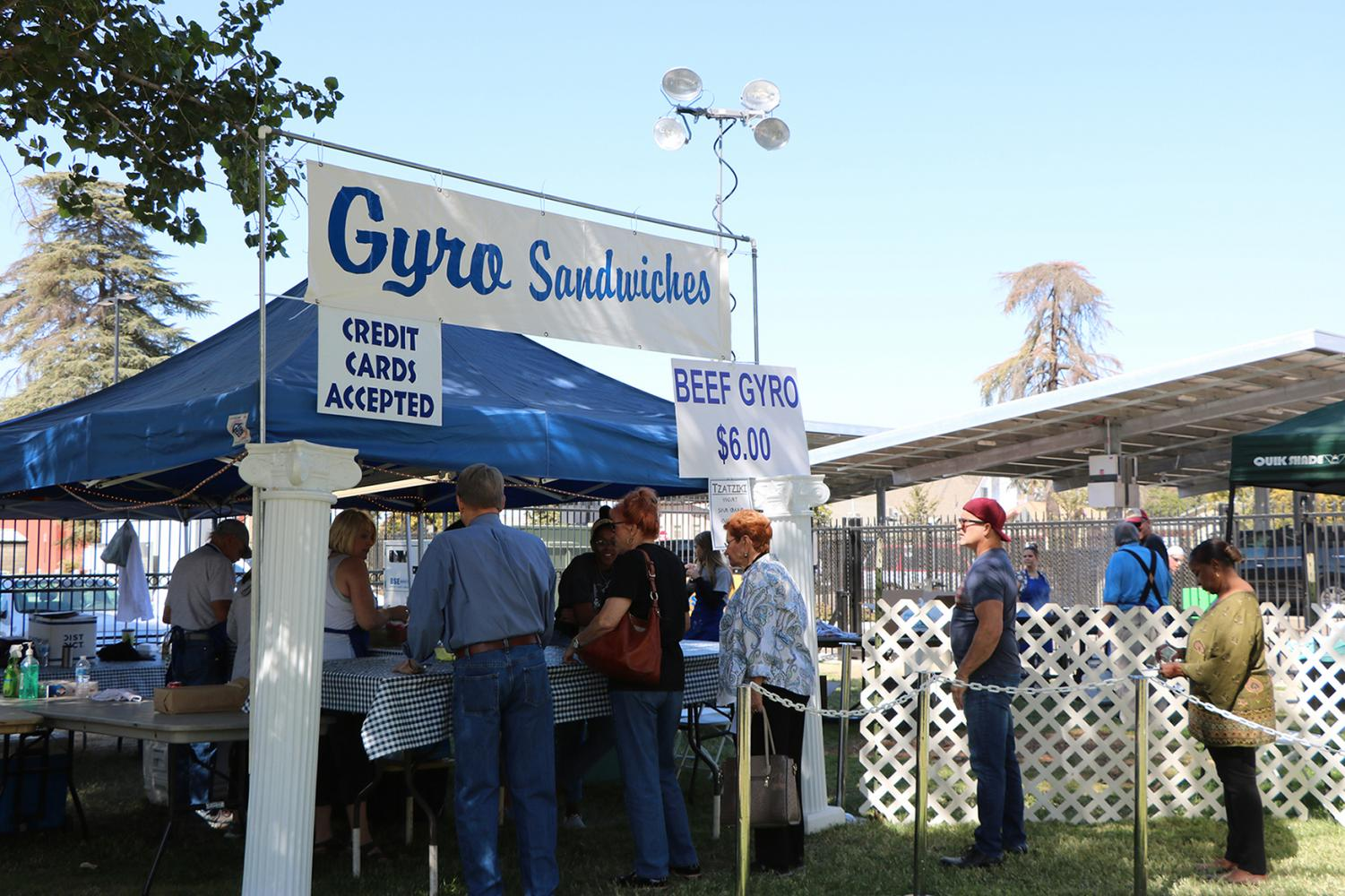 Visitors of the Greek Food Festival waiting in line for a Gyro Sandwich on Oct. 5.