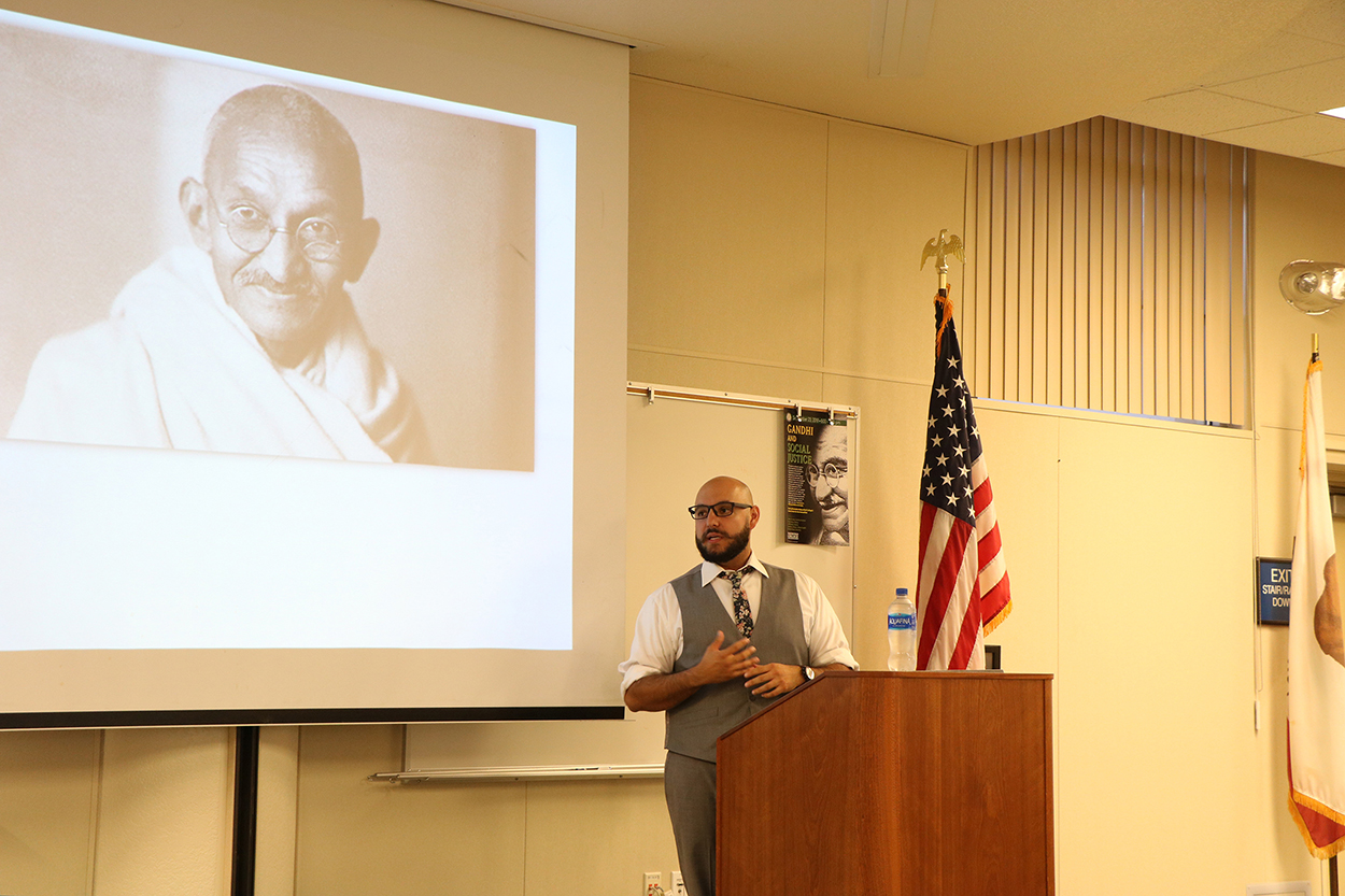 Jeff Newby speaking about Gandhi's life and upbringing in the Levan Center, Sept. 23.