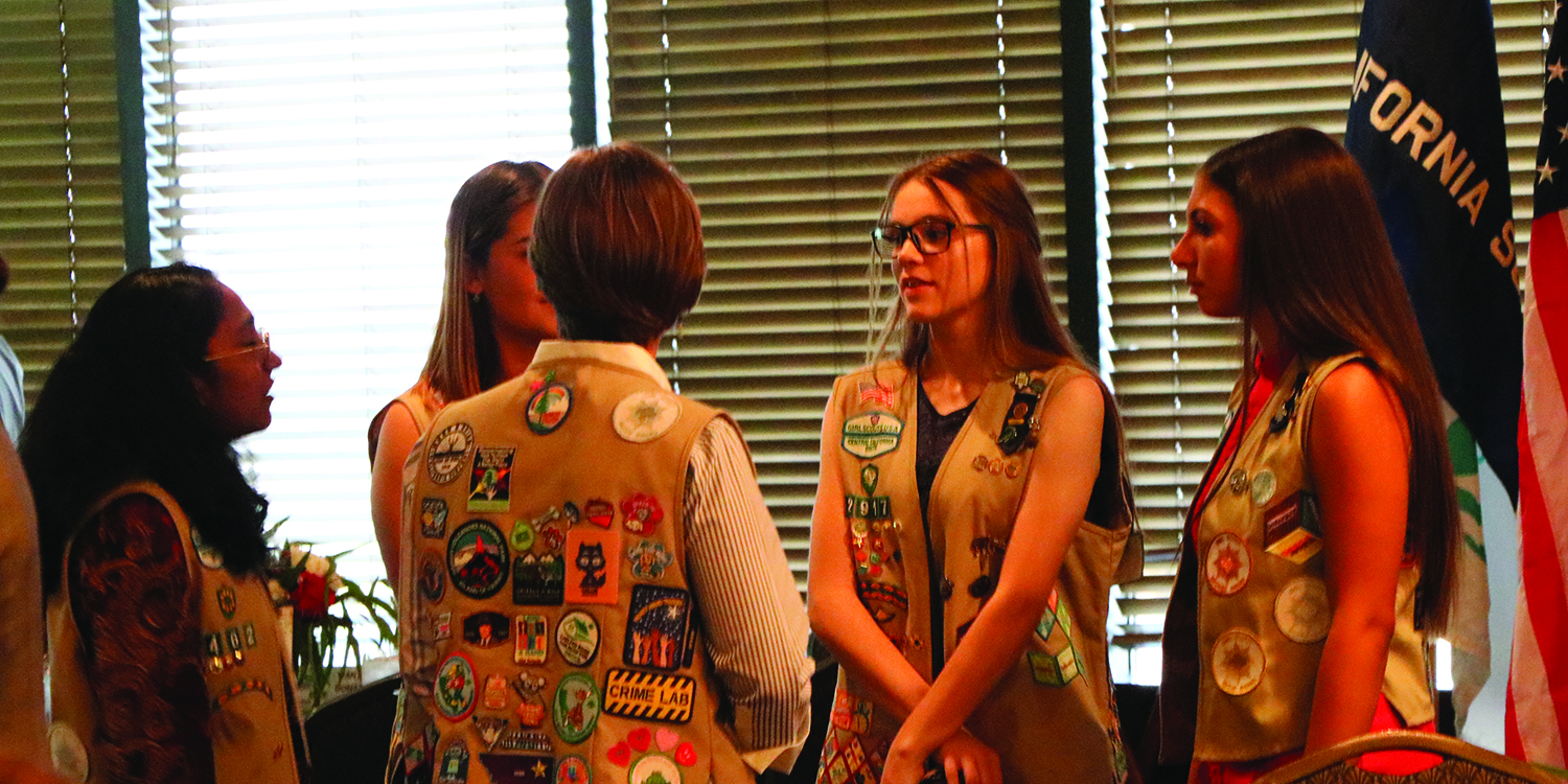 Girl Scouts Callie MCcakley (center), Vaishnari Samudrala (left), Alexsia Drulias (center), Jordan Rasmussen (right), and Cassidy Gereke (far right) are seen discussion their school life and what they love about being a part of Girl Scouts at the Girl Scouts Awards Dinner at Petroleum Club of Bakersfield on Oct. 11