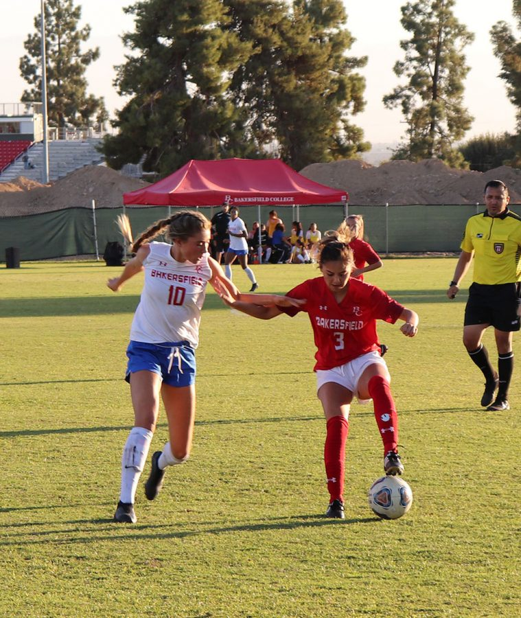 Makenna+Ramirez+%283%29+trying+to+dribble+Santa+Monica+defender+at+the+BC+Soccer+Field%2C+Oct.+18.+The+Renegades+took+the+loss+1-0.+