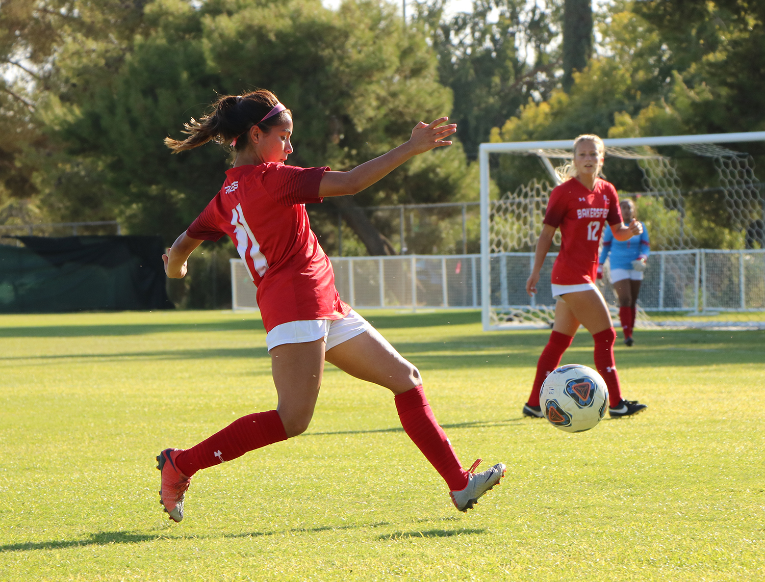 The Renegade's Alondra Tornero (11) about to passes the ball to teammate Nikolle Prather (12) during the first half of the Women's Soccer game against the Citrus College Owls at BC Soccer Field, on Oct. 8.