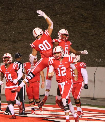 The Bakersfield College football team celebrating Shane Jonas's 33-yard touchdown in the second quarter during homecoming night at Memorial Stadium, Oct. 19. The Renegades dropped their conference opener to the Ventura College Pirates, 29-21.