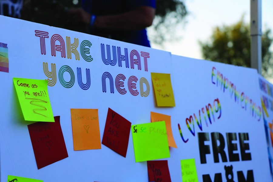 A poster board that displayed at the Free Mom Hugs tent with Post-It notes of encouraging words, put there by anyone that attendees who wanted to share words of kindness.