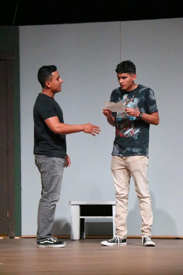 "TJ Sandoval (left) and Cameron Patterson (right) playing their characters in ""The Pillowman.""  The production is a dark comedy thriller that will be performed by the Bakersfield College theater department."