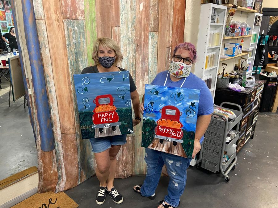 Michele Schmidt (left) and Heather Quiring (right) showing their finished pieces at the end of the Fall Drive painting session.