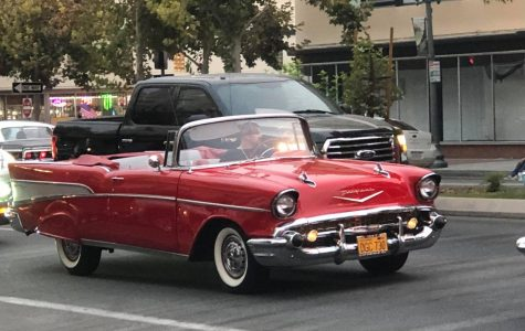 Red classic car cruising down Chester Ave.  during the Bakersfield Downtown Cruise, Sept. 11.