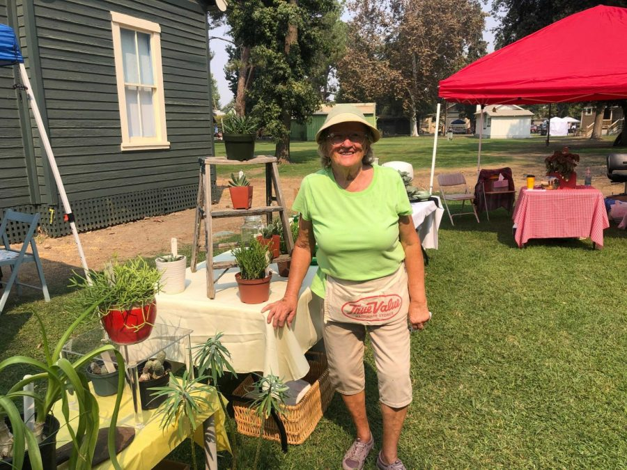 Donna Pitcher at her booth, Plants for You, showing off and selling her plants at the Village Outdoor Flea Market on Sunday Oct. 4.