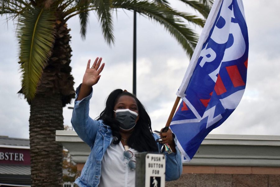A Biden supporter waving at passing cars on the corner of Coffee Road and Rosedale in North Bakersfield, CA, Nov. 7.