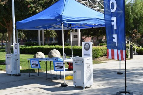 A curbside ballot drop off at Bakersfield College's main campus.