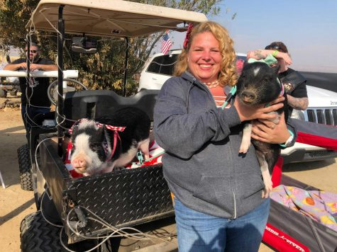 Misti Cole posing with her pet pigs at the Oildale Toy Run and Vets and Pets Winter Coat and Blanket Drive on Nov. 21.