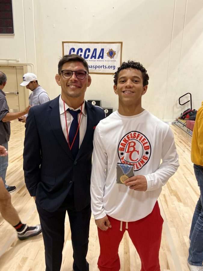 BC's recently announced head wrestling coach Marcos Austin (left) with former BC athlete Keithen Estrada (right) during the 2019 State Championship.