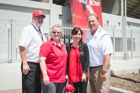 Chancellor Burke, Sandi Taylor, Sonya Christian, and Jeff Chudy posing outside the BC stadium.