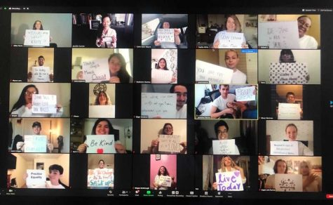 The Bakersfield Choirs rehearsing through Zoom while holding up inspirational quotes.