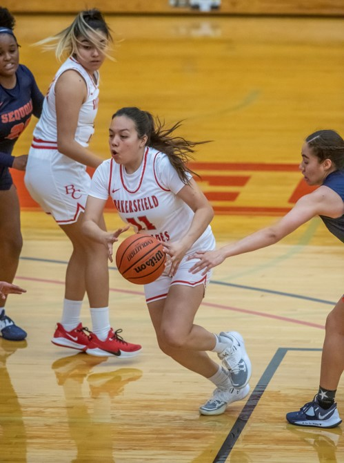 Julie Hernandez (11) was top scorer of the team for the game.  BC women's basketball team beat the Allan Hancock Bulldogs with the close score of 59-58 on March 12.